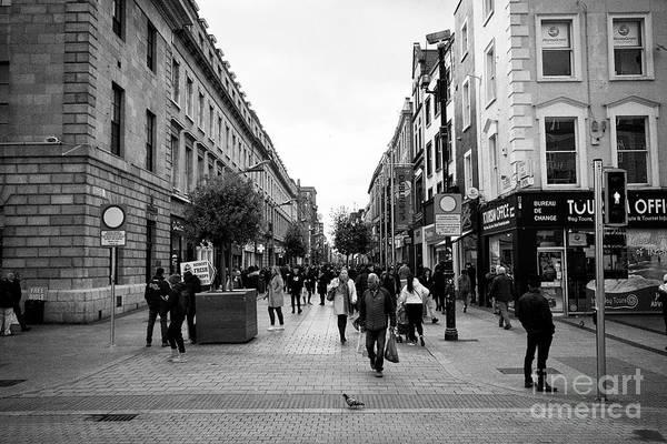Wall Art - Photograph - Looking Along Henry Street From Oconnell Street Dublin Republic Of Ireland Europe by Joe Fox