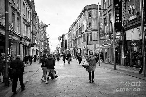 Wall Art - Photograph - Looking Along Henry Street From The City Centre Dublin Republic Of Ireland Europe by Joe Fox