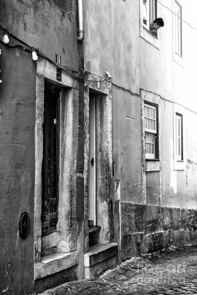 Wall Art - Photograph - Looking Out In Lisboa by John Rizzuto