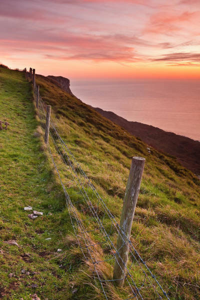 Wall Art - Photograph - Looking Over A Fence To The Coastline by Julian Elliott Photography