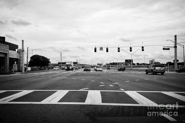 Wall Art - Photograph - looking through car windshield waiting for lights to turn to turn left at intersection Jacksonville  by Joe Fox