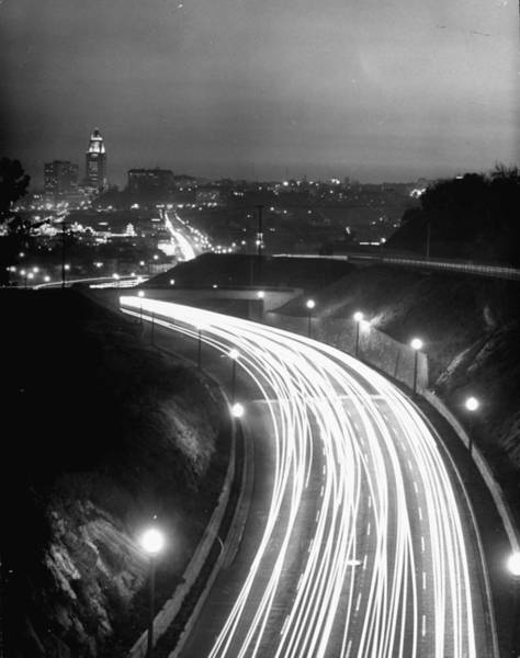 Photograph - Los Angeles Traffic Traveling At Night by Loomis Dean