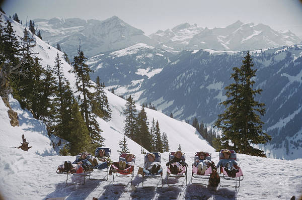 Group Of People Photograph - Lounging In Gstaad by Slim Aarons