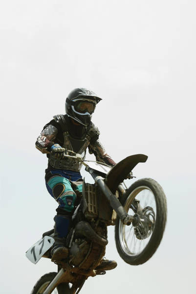 Motocross Photograph - Low Angle View Of A Motocross Rider by Glowimages
