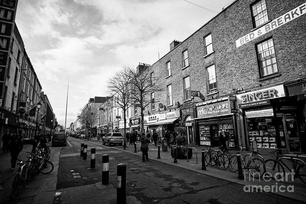 Wall Art - Photograph - low price and immigrant shops on talbot street Dublin Republic of Ireland Europe This is the approxi by Joe Fox