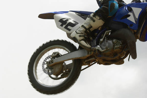 Motocross Photograph - Low Section View Of A Motocross Rider by Glowimages