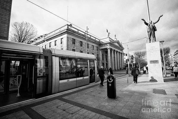 Wall Art - Photograph - Luas The Gpo And Jim Larkin Statue On Oconnell Street Dublin Republic Of Ireland Europe by Joe Fox