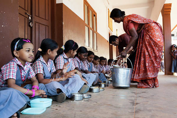 Bucket Photograph - Lunchtime For Students In A School In by Simon Rawles