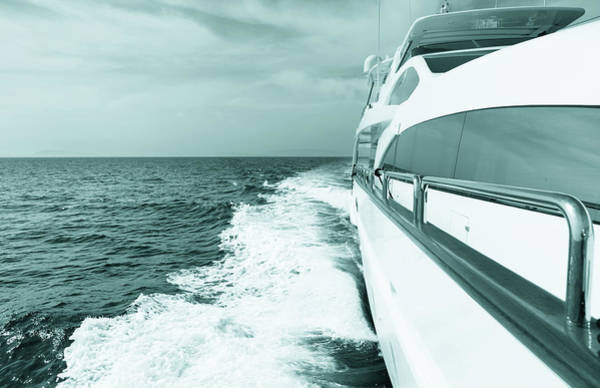 Yacht Photograph - Luxury Yacht Sailing At Sea. Blue Toned by Petreplesea
