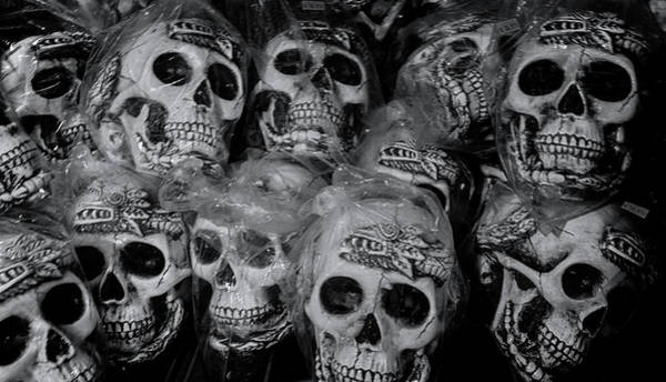 Photograph - Macabre Plastic Skulls by Tom Singleton