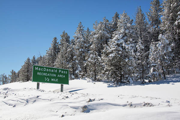 Photograph - Macdonald Pass Sign In The Winter Time by Tatiana Travelways