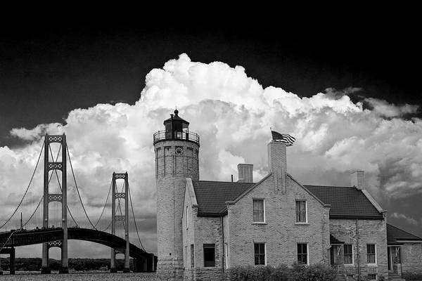 Photograph - Mackinac Bridge And The Mackinaw City Lighthouse In Black And White by Randall Nyhof