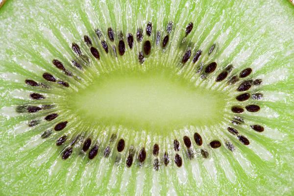 Slice Photograph - Macro Of Sliced Kiwi by Siri Stafford