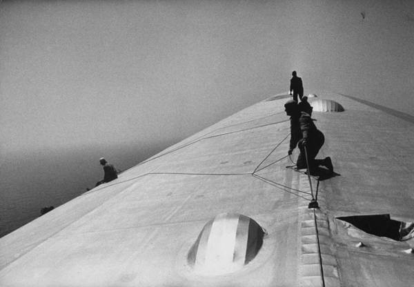 Photograph - Maintenance Crewmen Climbing On Top Of G by Alfred Eisenstaedt