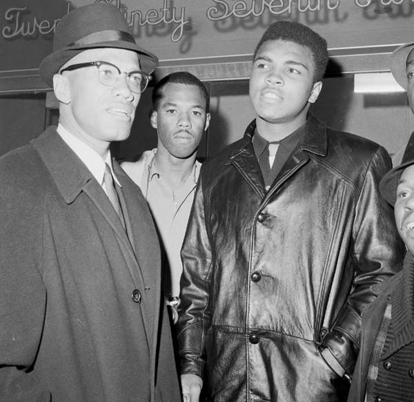 Usa Photograph - Malcolm X Left With Cassius Marcellus by New York Daily News Archive