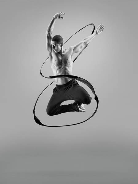 Improvement Photograph - Male Athlete Jumping In Liquid Splsh by Jonathan Knowles