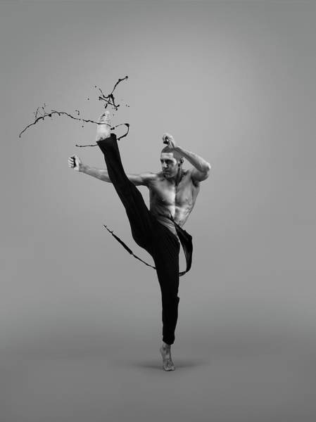 Shirtless Photograph - Male Athlete Kicking Liquid Splash by Jonathan Knowles