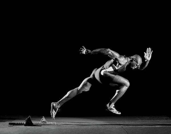 Shaved Head Photograph - Male Athlete Sprinting  From Starting by Mike Powell