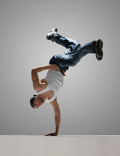 Upside Down Photograph - Male Breakdancer Balancing On One Hand by John Lamb