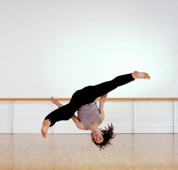Upside Down Photograph - Male Dancer Jumping Upside Down In Mid by Nick White