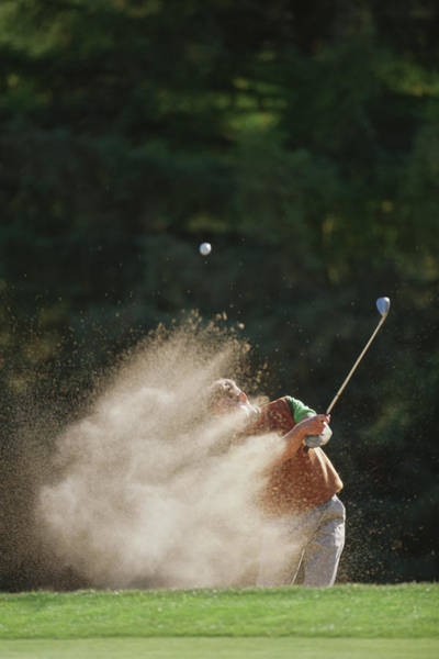 Trapped Photograph - Male Golfer Hitting Out Of A Sand Trap by David Madison