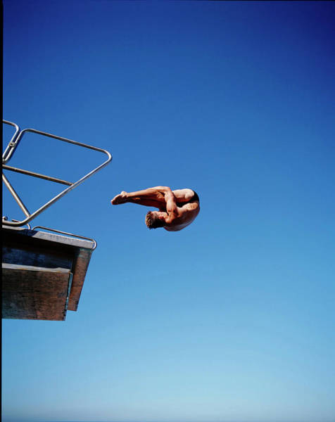 Diving Board Photograph - Male Swimmer Diving From High Board by Nick Clements