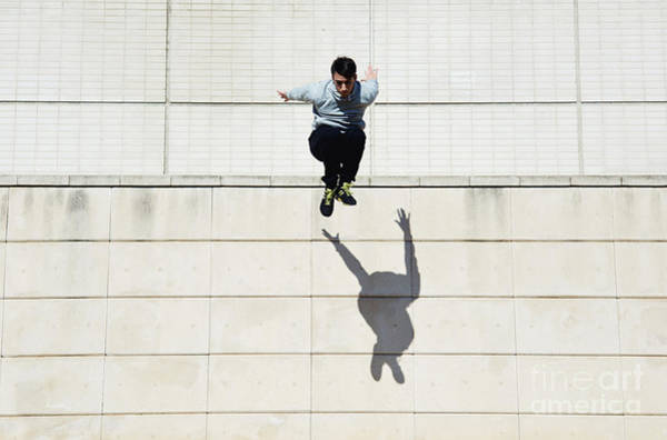Cement Wall Art - Photograph - Male Tracer Free Runner Jumping Forward by Gaudilab
