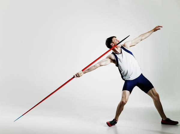 Javelin Photograph - Male Track Athlete Preparing To Throw by Thomas Barwick