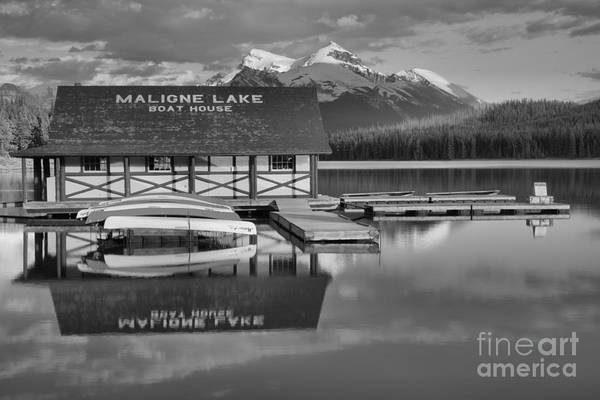 Photograph - Maligne Lake Boathouse Summer Refelctions Black And White by Adam Jewell