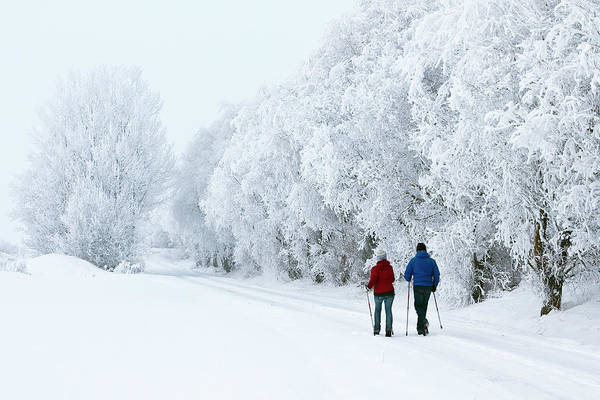 People Walking Photograph - Man And Woman Walking In A Winter by Johan Klovsjö