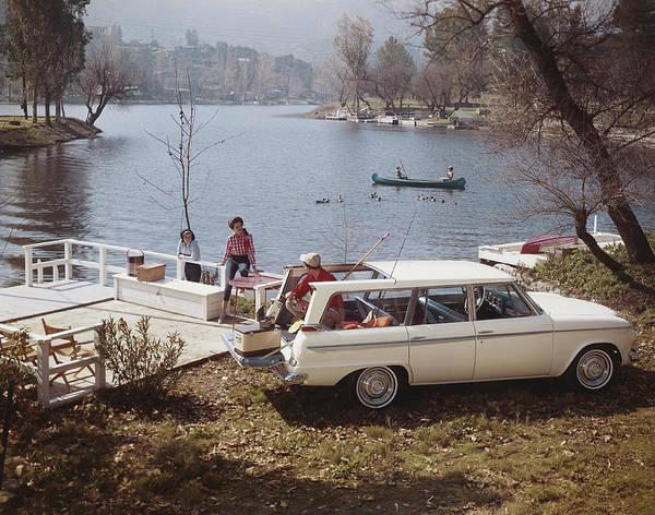 Photograph - Man And Women Having Fun Near Lake by Tom Kelley Archive