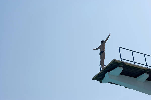 Diving Board Photograph - Man Balancing On Edge Of Diving Board by Fredrik Clement