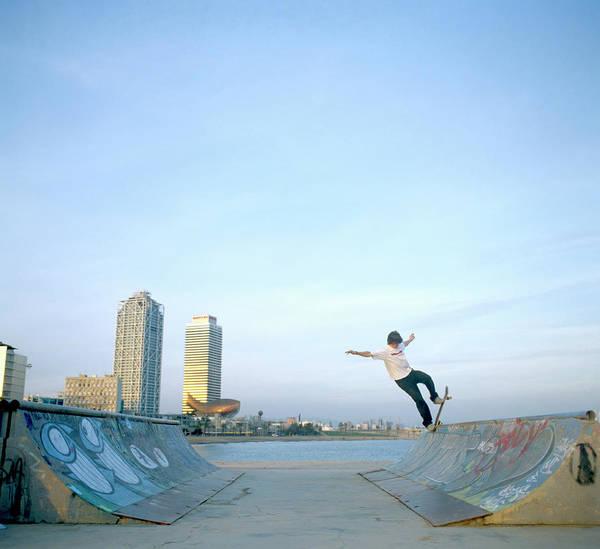Skateboard Photograph - Man Balancing Skateboard On Ramp by Paul Calver