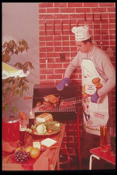 Barbecue Photograph - Man Barbecuing A Meal, 1980s by Archive Holdings Inc.