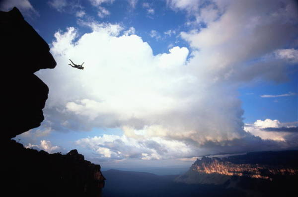 Base Jumping Photograph - Man Base Jumping Off Angel Falls by Ken Fisher