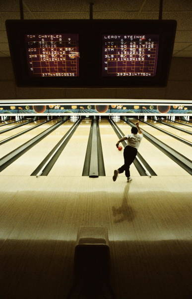 Ten Pin Bowling Wall Art - Photograph - Man Bowling In Bowling Alley, Rear View by David Joel