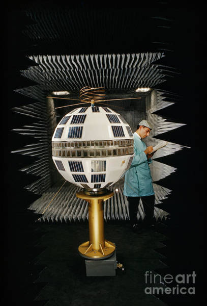 Photograph - Man Checks Antenna On Mockup Of Telstar, A Communications Satellite. by Robert Goodman