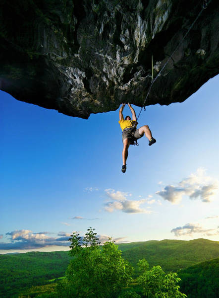 Hanging Rock Photograph - Man Climbing Overhanging Rock, Low by Tyler Stableford