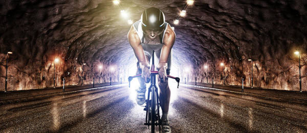 Helmet Photograph - Man Cycling Through Tunnel by Johner Images