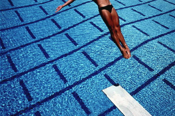 Diving Board Photograph - Man Diving Backwards From Board Into by Pete Turner