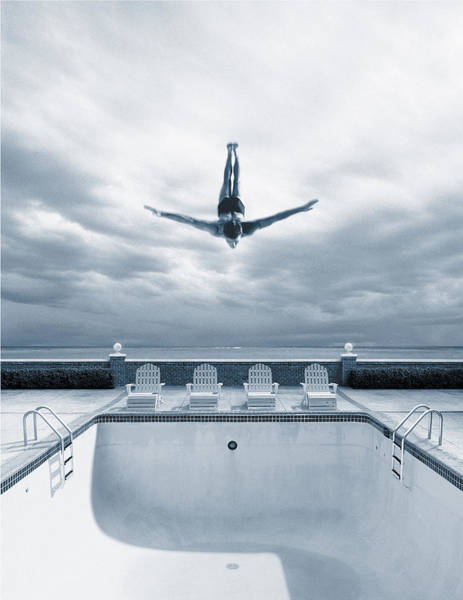 Bleached Photograph - Man Diving Into An Empty Pool by Joseph Hancock