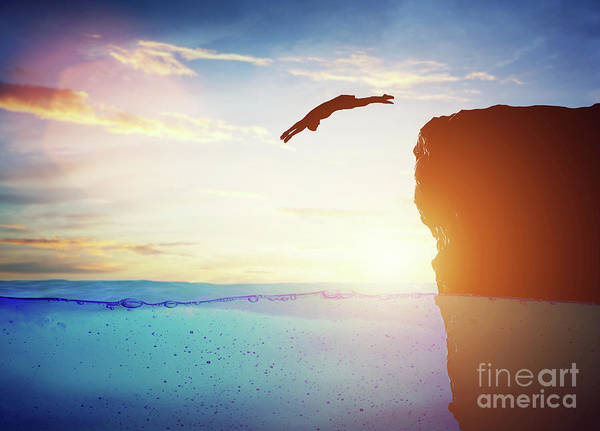 Free Dive Wall Art - Photograph - Man Diving Into Water From High Cliff To The Unknown. by Michal Bednarek