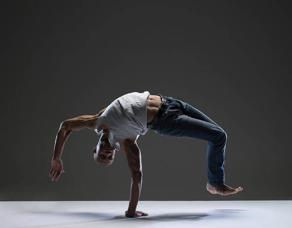 Shaved Head Photograph - Man Doing Dance Move by Stewart Sutton