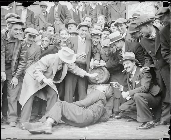 Photograph - Man Drinking From Keg by Bettmann