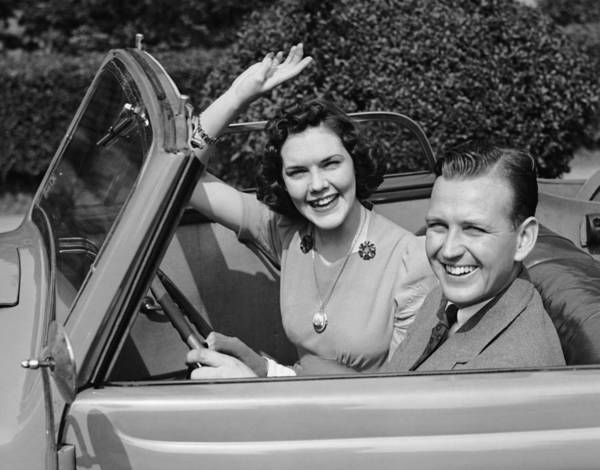 Heterosexual Couple Photograph - Man Driving Car And Woman Waving by George Marks