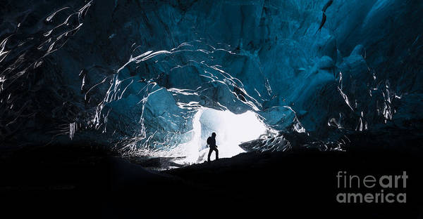 Explorer Wall Art - Photograph - Man Exploring An Amazing Glacial Cave by J. Helgason