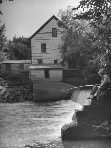 Small Town Usa Photograph - Man Fishing Beside A Waterfall And A 100 by Bob Landry