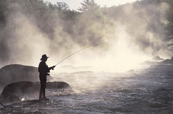 New Hampshire Photograph - Man Fly-fishing In Contoocook River by David White