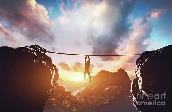 Photograph - Man Hanging On Rope Between Two High Mountains by Michal Bednarek