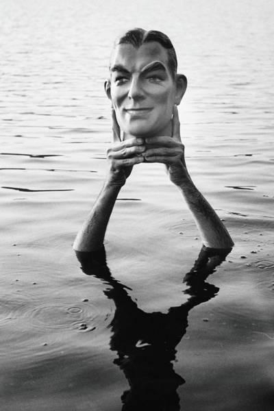 Photograph - Man Holding Plaster Head Above Water B&w by Alfred Gescheidt